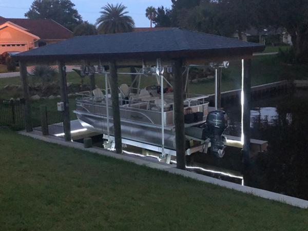 Custom boat house, boat lift, and L shape dock