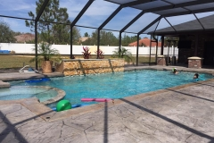 Custom-pool-spa-with-stamped-concrete-deck