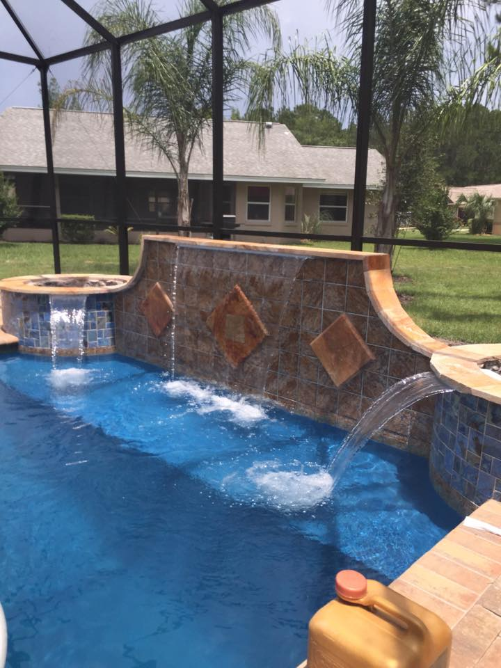 Custom in ground pool in Palm Coast by Agua Construction Waterfalls