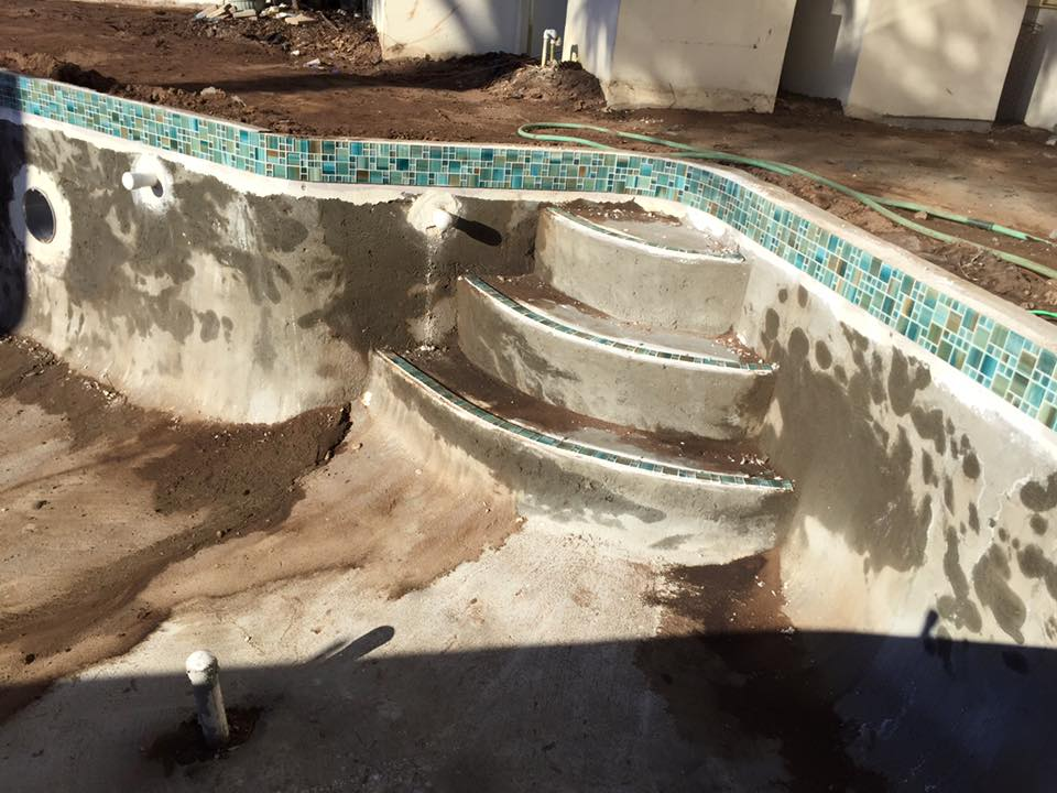 Installing decorative tiles for custom pool in St Augustine