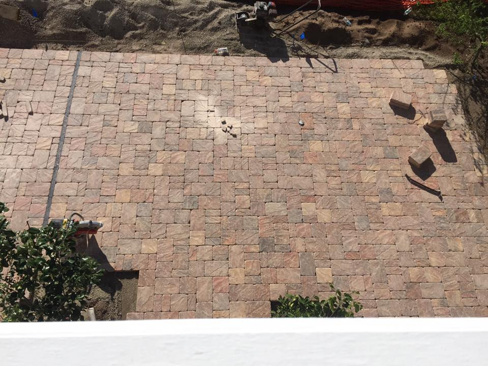 installing pavers for custom pool in St Augustine