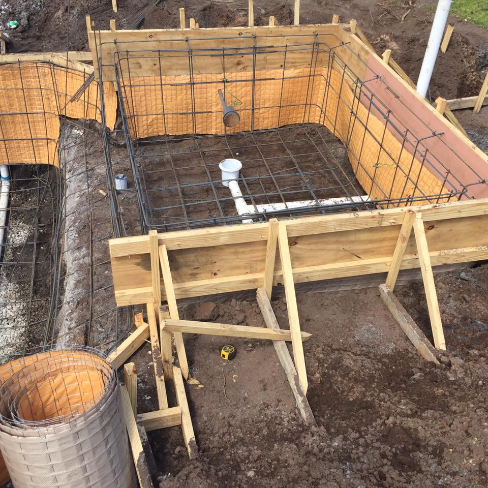 Steel framing and plumbing for spa.