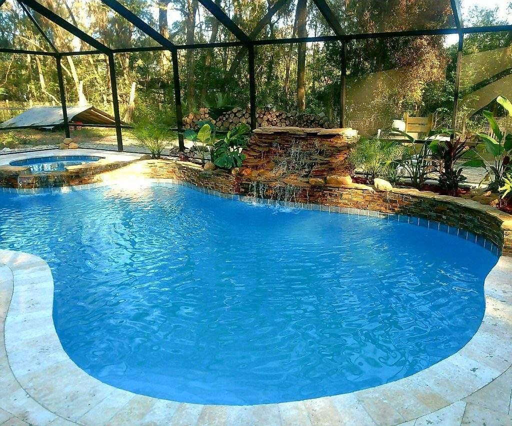 Custom pool and spa with raised wall waterfall.